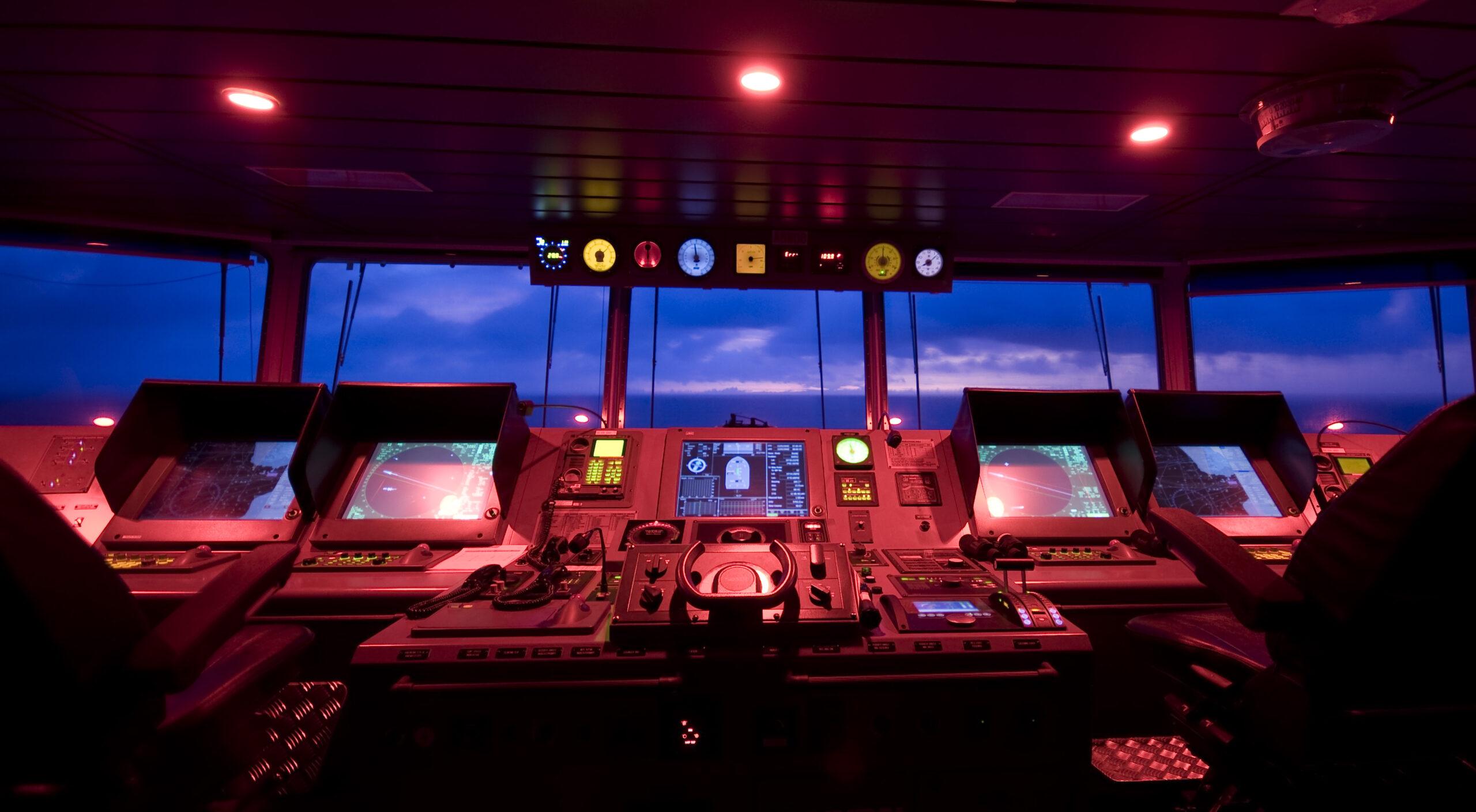 bridge of a modern cargo ship and dusk
